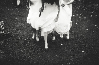bride walking with maids